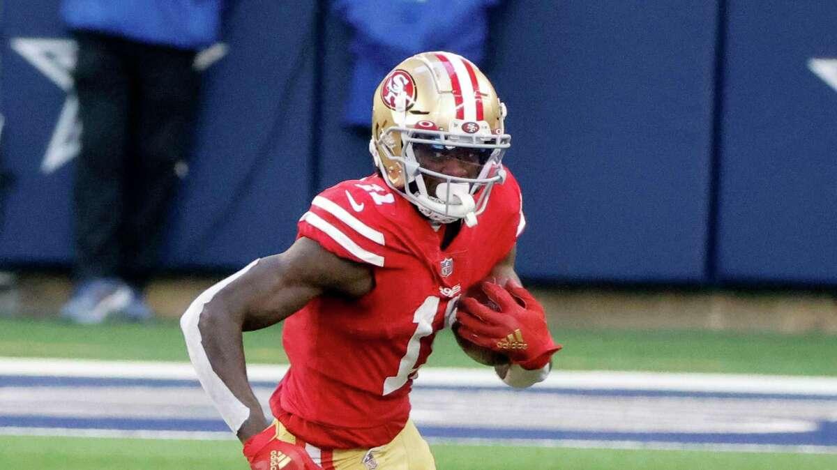 San Francisco 49ers wide receiver Brandon Aiyuk (11) runs with the ball during an NFL football game in Arlington, Texas, Sunday, Dec. 20, 2020. (AP Photo/Michael Ainsworth)