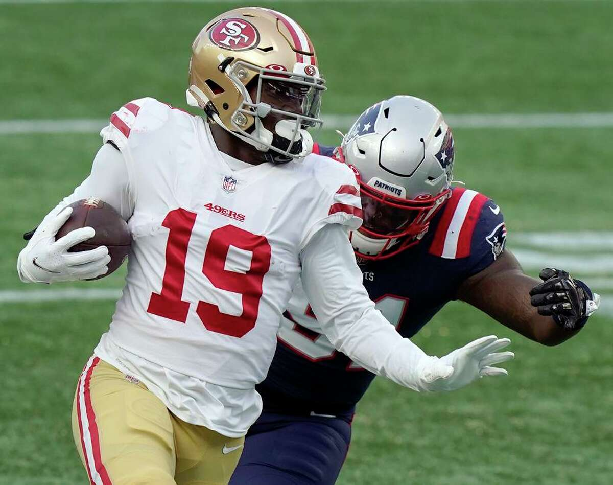 San Francisco 49ers wide receiver Deebo Samuel (19) runs from New England Patriots linebacker Ja'Whaun Bentley after catching a pass in the first half of an NFL football game, Sunday, Oct. 25, 2020, in Foxborough, Mass. (AP Photo/Steven Senne)
