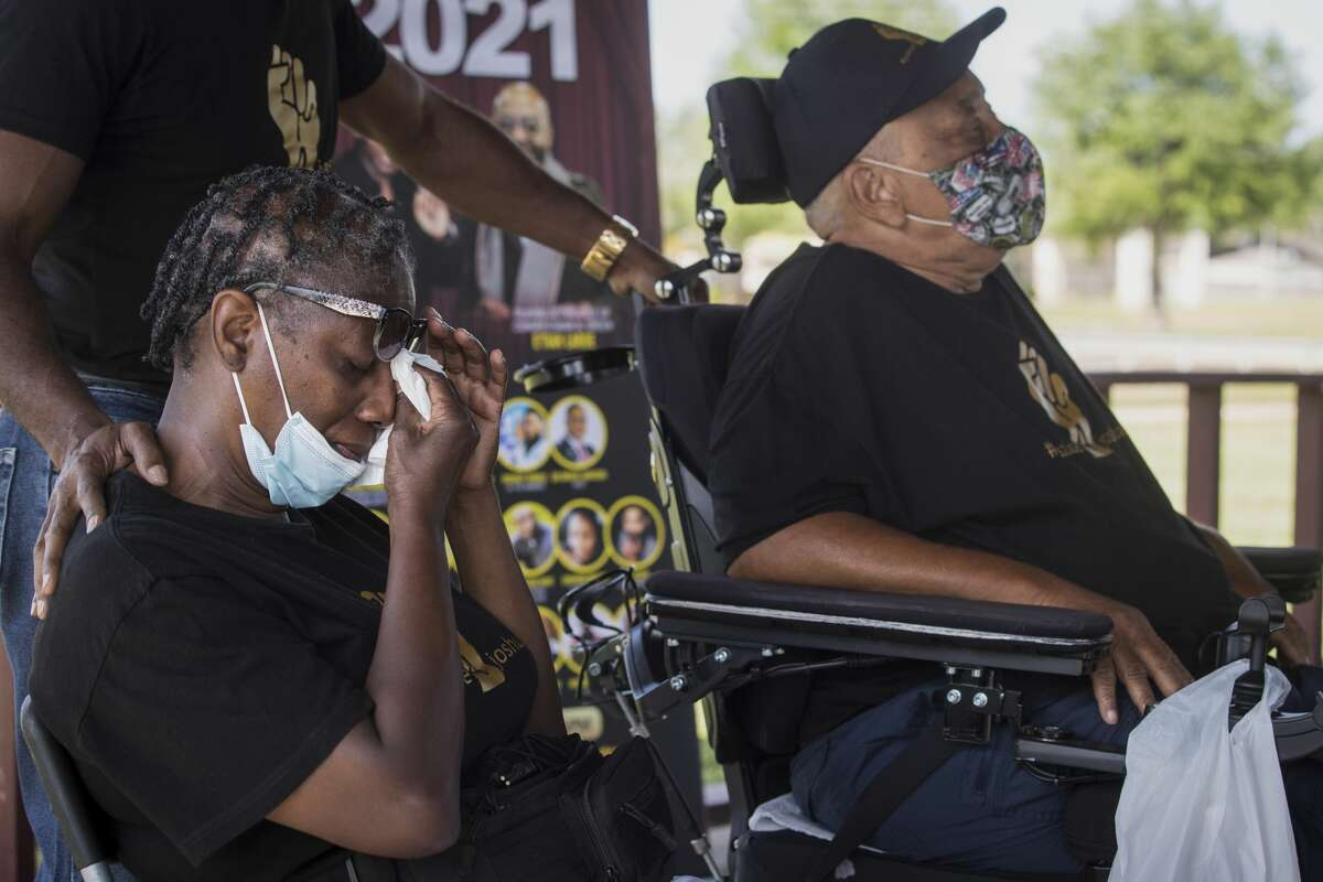 Wilhelmina Beary, left, wipes her eyes as she sits with her husband, Richard, during a vigil calling for justice for their son, Joshua Johnson on April 25, in Missouri City. Joshua was shot and killed in April 2020 by an undercover Harris County Sheriff's deputy. Friends believe Johnson thought the deputy was a possible burglar.