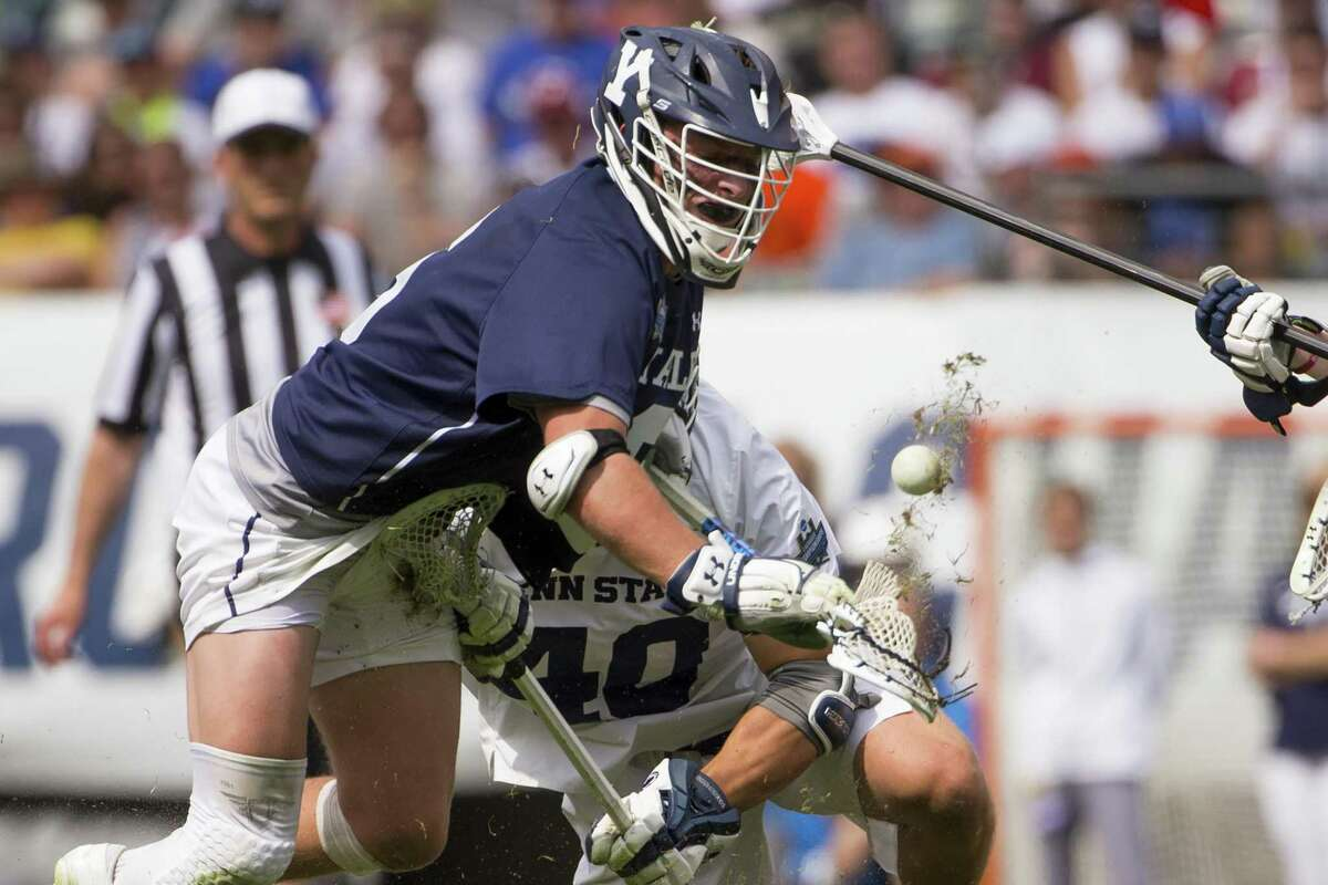 Yale's TD Ierlan (6) wins a faceoff against Penn State's Gerard Arceri (40) in the 2019 NCAA championship semifinals.