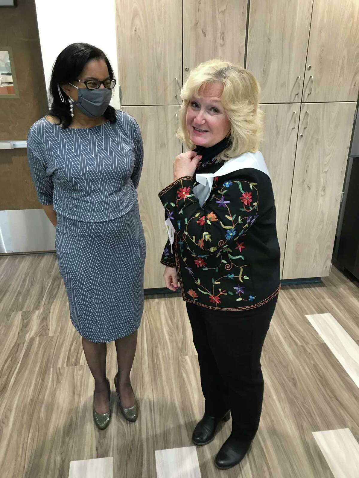 Youth Services Program Assistant Marcia Sacco, right, speaking with Bonnie Price, Cromwell's human resources coordinator, during a get-together marking Sacco's retirement.