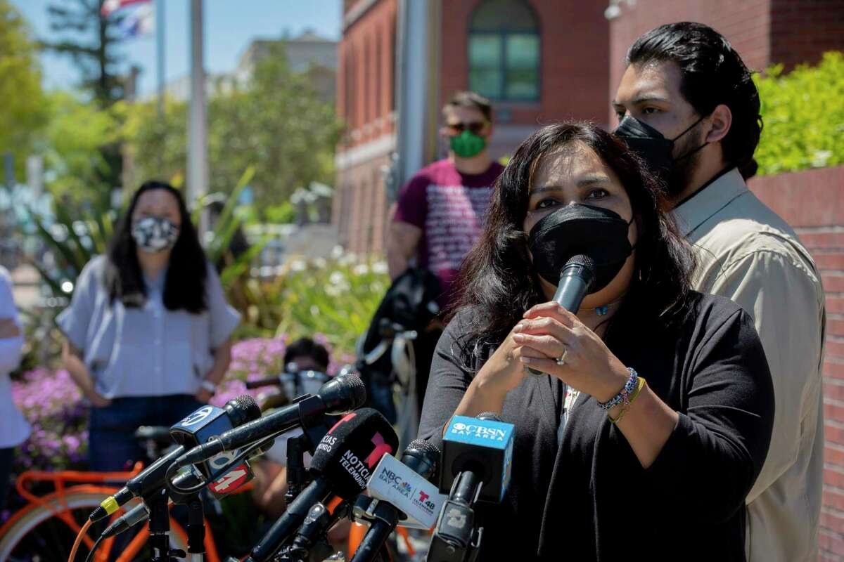 The mother of Mario Gonzalez, Edith Arenales, makes a statement at a news conference outside the Alameda Police Department on Tuesday.