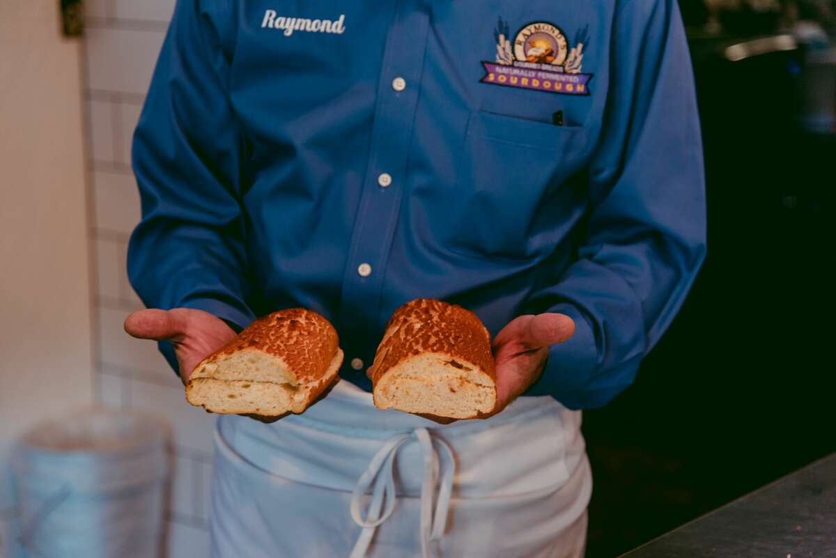 Raymond Ofiesh, founder and CEO of Raymond's Sourdough Bread, holds freshly baked Dutch crunch bread at his bakery outlet in South San Francisco, Calif., on Thursday, April 15, 2021.