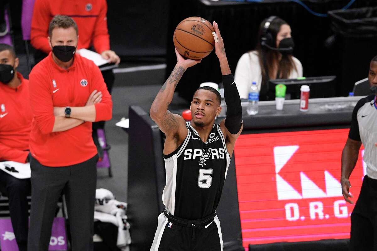 San Antonio Spurs guard Dejounte Murray (5) shoots during the first half of an NBA basketball game against the Washington Wizards, Monday, April 26, 2021, in Washington. (AP Photo/Nick Wass)