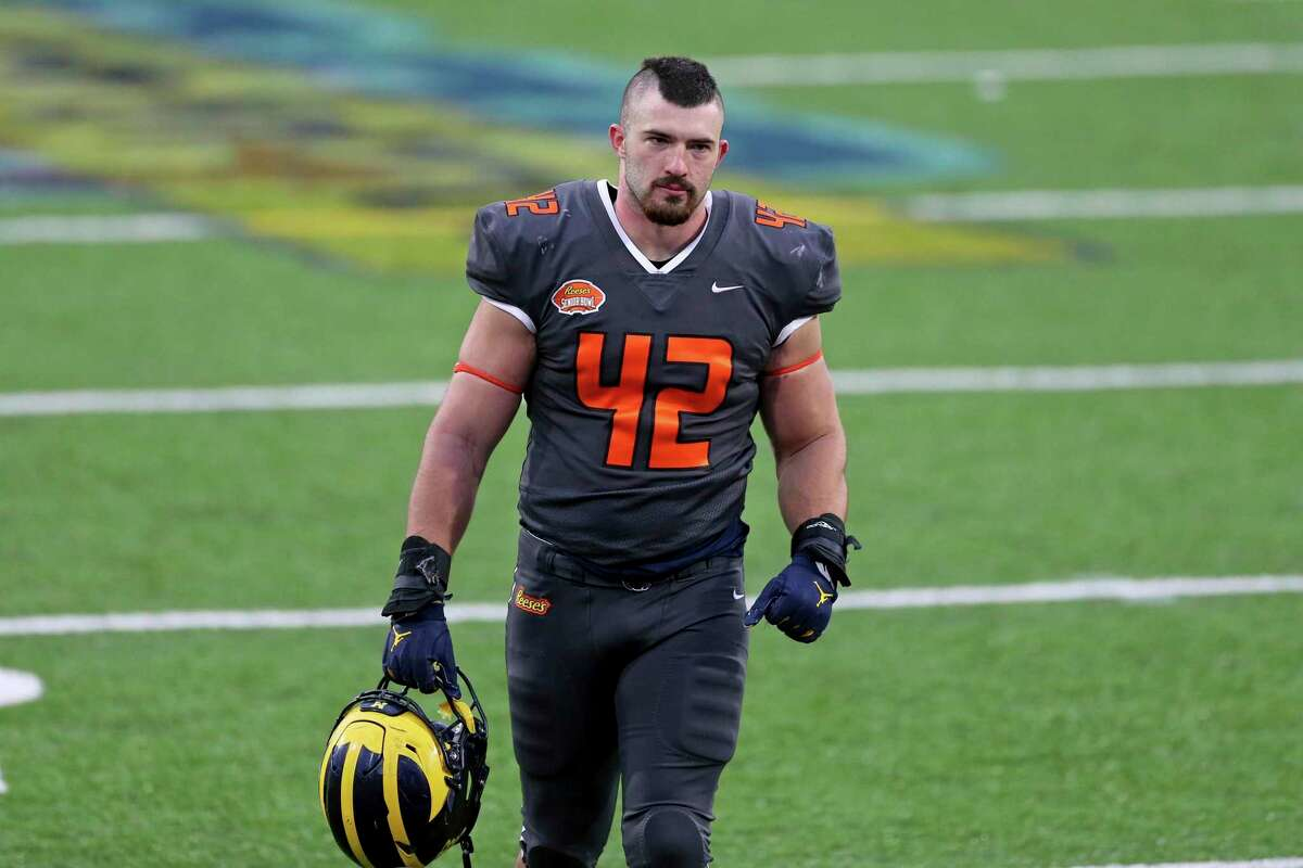 National Team fullback Ben Mason of Michigan (42) walks off the field after January's Senior Bowl in Mobile, Ala.