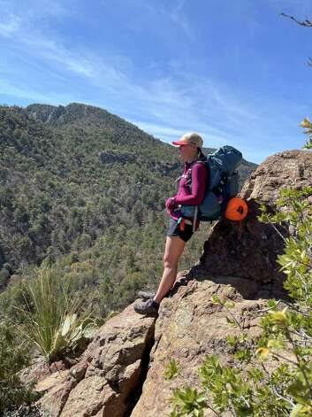 Em Capito of Salt Lake City rests her pack on a rock overlooking Boot Canyon in Big Bend National Park in March. Boot Canyon Trail is still closed after a fire early this month. Photo: Melissa Aguilar/Houston Chronicle
