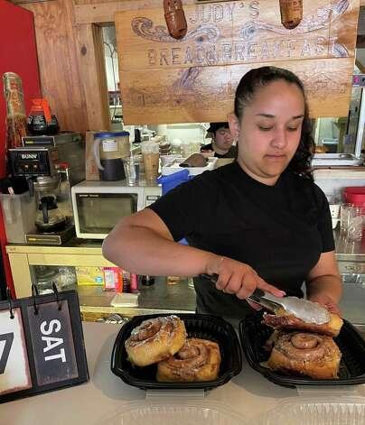 Abigail serves up fresh cinnamon rolls at Judy's Bread & Breakfast in Alpine. Photo: Melissa Aguilar/Houston Chronicle