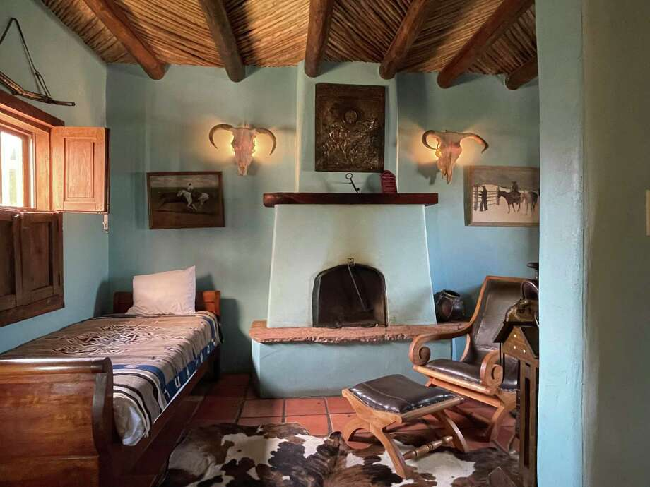 The Owner's Suite at The Gage Hotel in Marathon is painted robin-egg blue and has a king bed, as well as a twin. Photo: Melissa Aguilar/Houston Chronicle