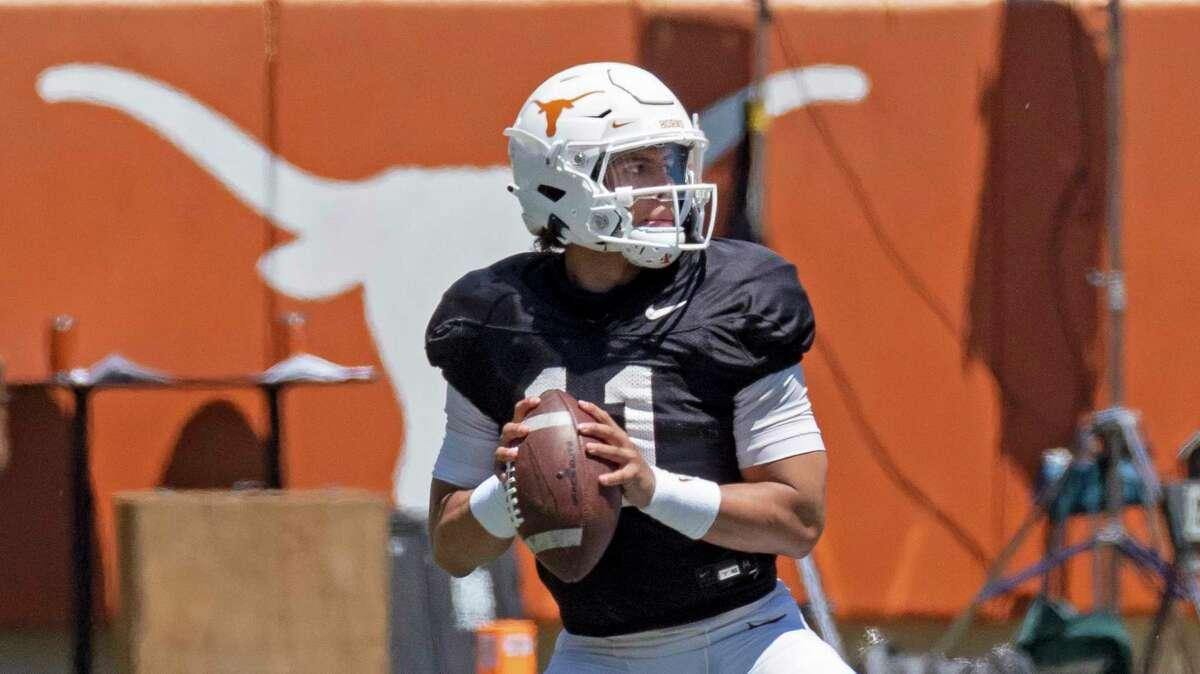 Texas quarterback Casey Thompson looks to pass during the final half of the Texas Orange and White Spring Scrimmage in Austin, Texas, Saturday, April 24, 2021. (AP Photo/Michael Thomas)
