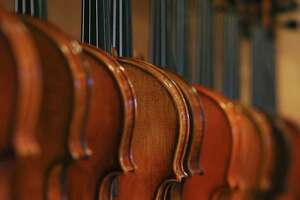 Violins are on display for sale at Terra Nova Violins, Thursday, April 22, 2021. Owner Abbas Selgi immigrated to San Antonio from Iran in 1997. Selgi, 57, had a successful violin-making shop in Iran. He currently owns two violin making stores, in San Antonio and Austin.