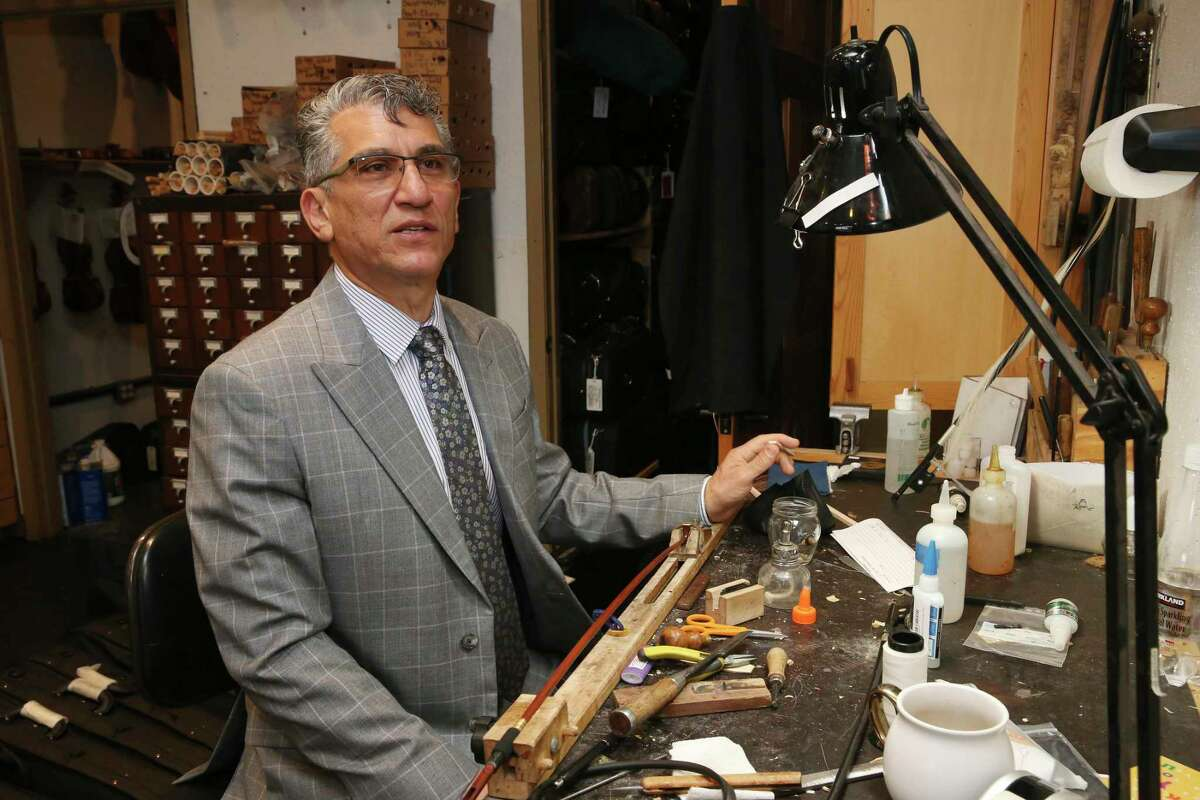 Abbas Selgi, owner of Terra Nova Violins, sits at his workstation, Thursday, April 22, 2021. Selgi immigrated to San Antonio from Iran in 1997. Selgi, 57, had a successful violin-making shop in Iran. He currently owns two violin making stores, in San Antonio and Austin. The sons will be headed to Europe to learn the art of violin making.