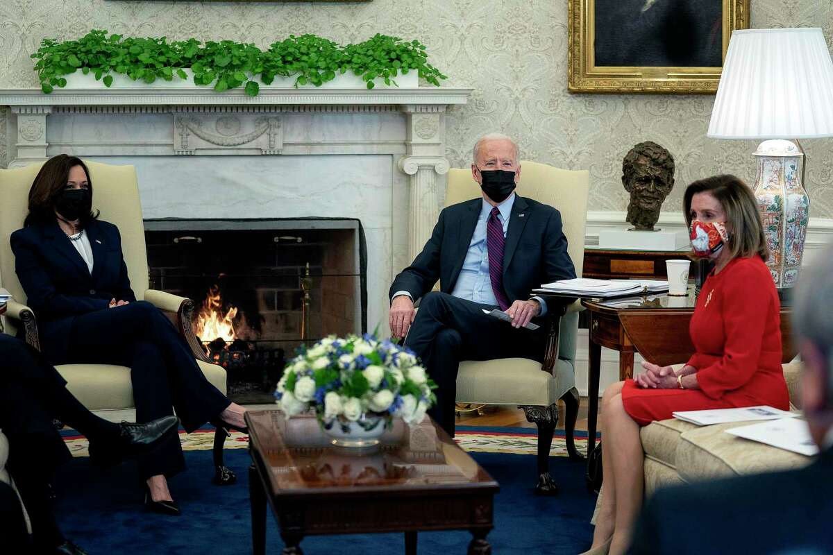 Vice President Kamala Harris and Speaker of the House Nancy Pelosi meet with President Biden at the Oval Office in February. When Harris and Pelosi take their seats behind the president for his speech to Congress on Wednesday, the majority of politicians on the dais will be women.