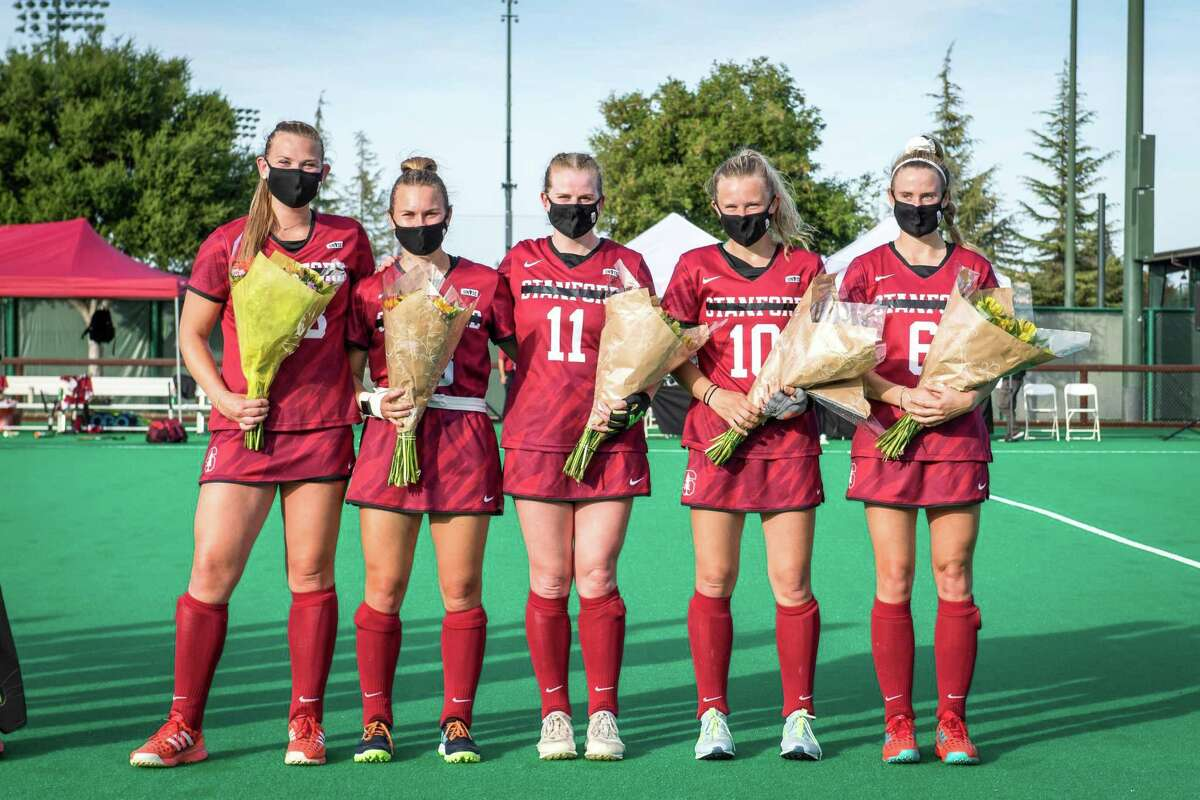 On Senior Day, Stanford field hockey players put black tape over the university name on their uniforms. The program was told it will be cut but the team plays on, the NCAA tourney next.