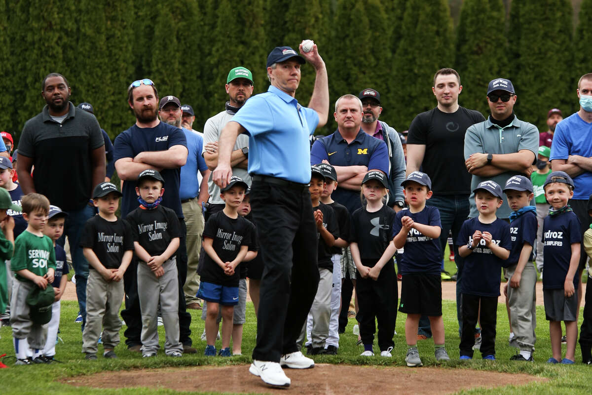 David Gessford throws out the first pitch of the season as Northeast Little League teams, coaches and parents celebrate during their opening day ceremony Tuesday, April 27, 2021 at Plymouth Park. (Doug Julian/for the Daily News)