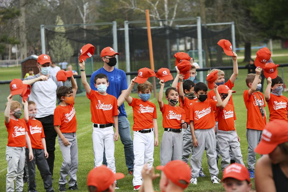 Northeast Little League teams, coaches and parents celebrate a new season during their opening day ceremony Tuesday, April 27, 2021 at Plymouth Park. (Doug Julian/for the Daily News)