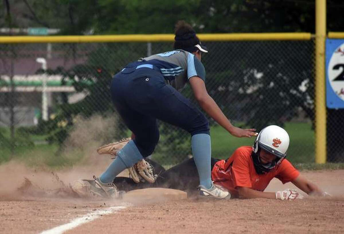 Edwardsville's Lexie Gorniak slides safely into third base on a wild pitch during the fifth inning against Belleville East on Tuesday in Belleville.