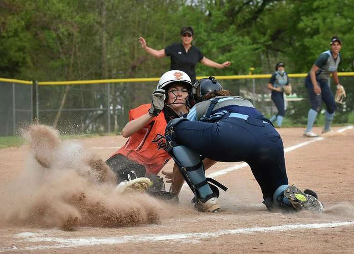 Edwardsville's Ryleigh Owens attempts to score a fly ball in the fourth inning against Belleville East on Tuesday in Belleville. Owens was called out on the play.