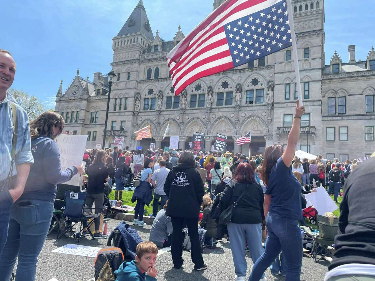 About 4,000 people surround the State Capitol on Tuesday, April 27, 2021, in a daylong attempt to derail the expected Senate vote that would force new students in all Connecticut schools and child care programs to be vaccinated by September 2022. The state Senate passed the measure Tuesday night.