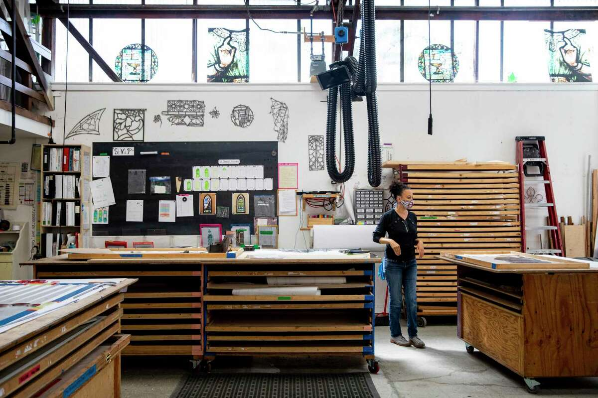 Ariana Makau, president of Nzilani Glass Conservation, walks through her studio space in Oakland.