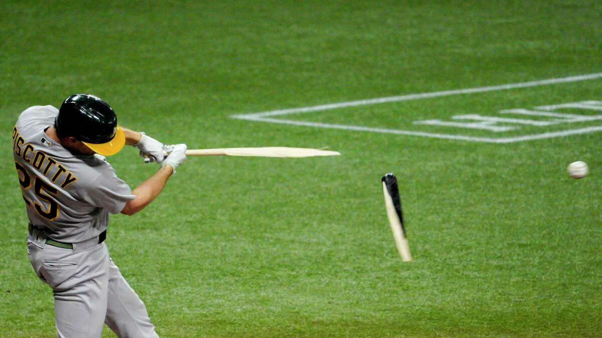 ST PETERSBURG, FLORIDA - APRIL 27: Stephen Piscotty #25 of the Oakland Athletics breaks his bat during the second inning against the Tampa Bay Rays at Tropicana Field on April 27, 2021 in St Petersburg, Florida. (Photo by Douglas P. DeFelice/Getty Images)