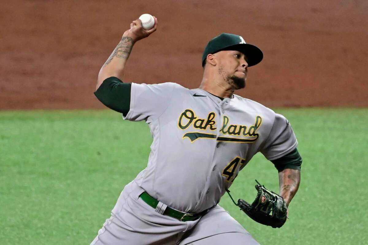 ST PETERSBURG, FLORIDA - APRIL 27: Frankie Montas #47 of the Oakland Athletics throws a pitch during the third inning against the Tampa Bay Rays at Tropicana Field on April 27, 2021 in St Petersburg, Florida. (Photo by Douglas P. DeFelice/Getty Images)
