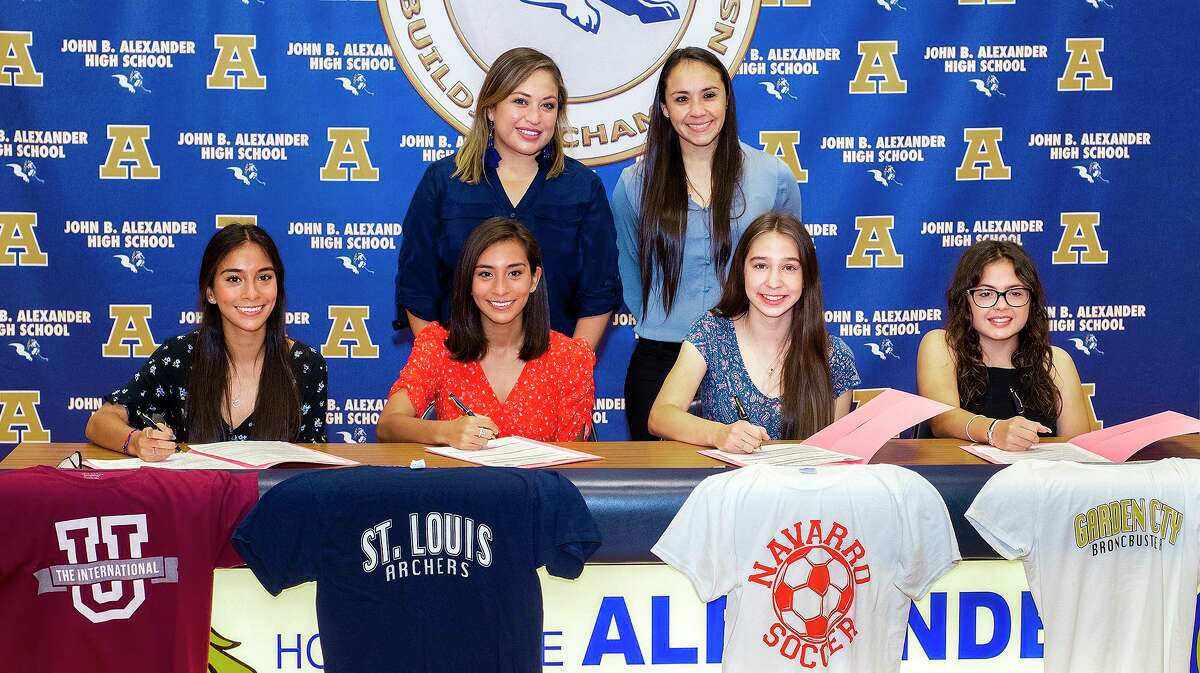 Alexander soccer coaches Karla De Leon and Erika Alcaraz join players Regina Nishiyama, Sara Nishiyama, Abigail Gonzalez and Idania Dominguez as they sign their National Letters of Intent to play for Texas A&M International University, St. Louis Community College, Navarro College and Garden City Community College, respectively, on Tuesday, April 27, 2021 at Alexander High School.