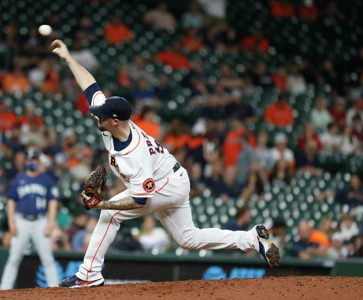Houston Astros relief pitcher Ryan Pressly (55) pitches during the ninth inning of an MLB baseball game at Minute Maid Park, Tuesday, April 27, 2021, in Houston.