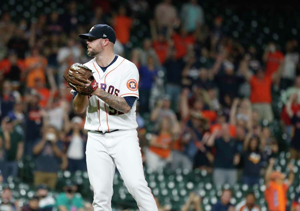 Houston Astros relief pitcher Ryan Pressly (55) celebrates after striking out Seattle Mariners Kyle Seager for the final out of the ninth inning of an MLB baseball game at Minute Maid Park, Tuesday, April 27, 2021, in Houston. Astros beat the Seattle Mariners 2-0.