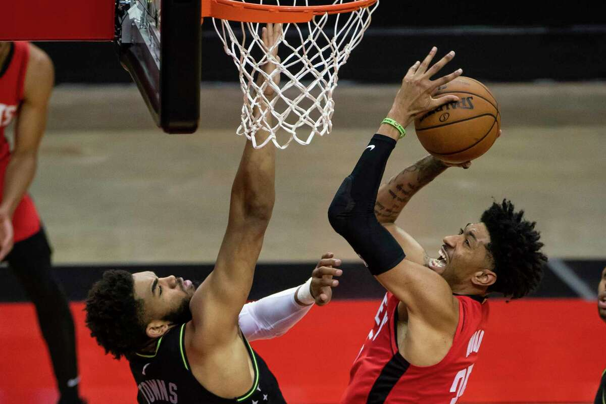 For the second time this season, Rockets center Christian Wood (right) faced off against Timberwolves star big man Karl-Anthony Towns on Tuesday, with Towns' team again getting the victory.