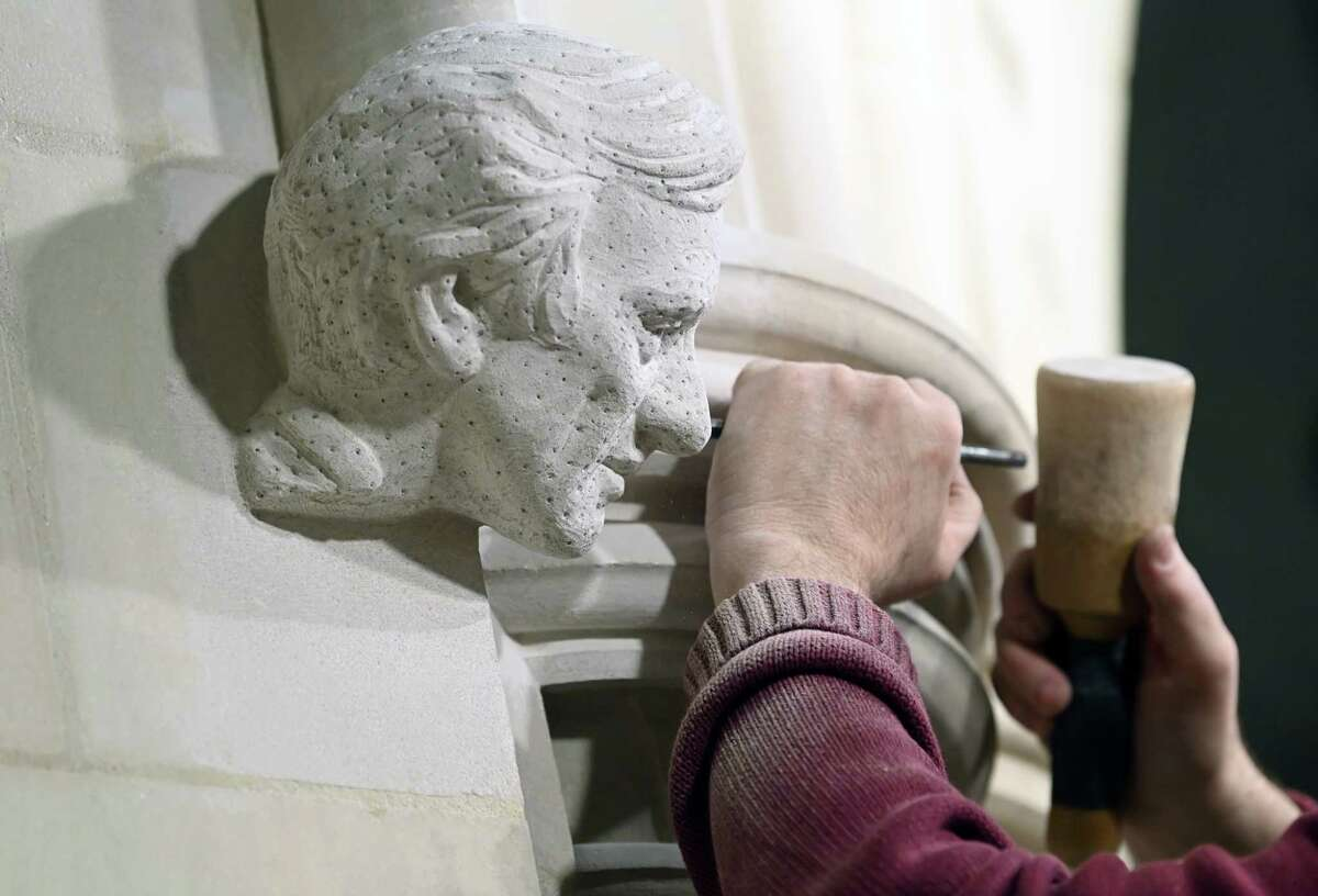 Stonemason Sean Callahan works on a sculpture of Elie Wiesel in Washington National Cathedral on March 18.