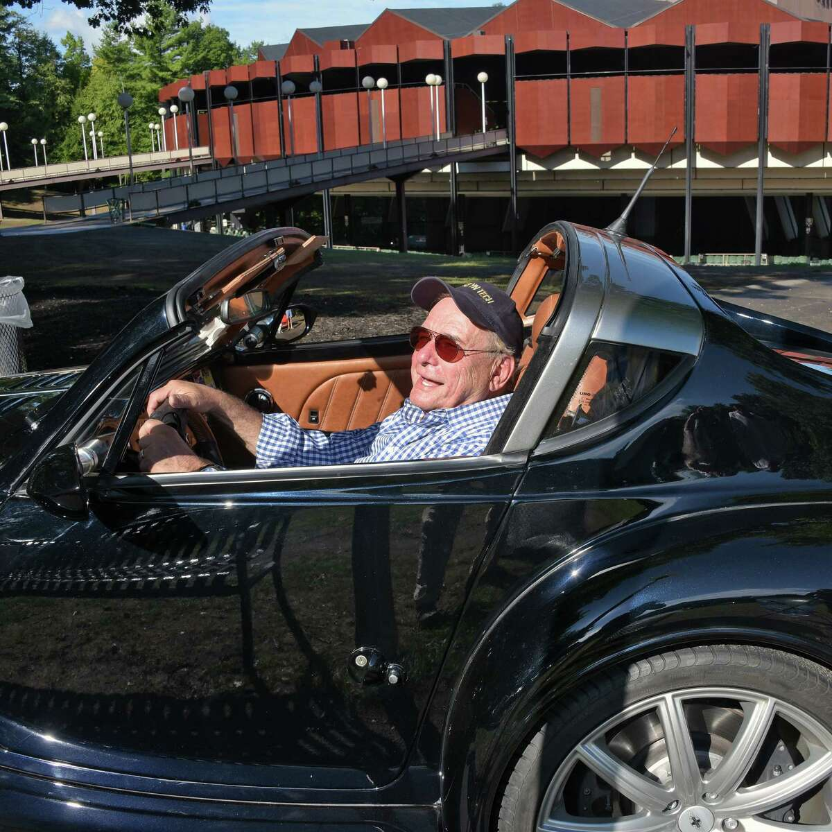 Dr. Joel Spiro of Albany drives his 2010 Morgan Aero SuperSports past the SPAC amphitheater during the Saratoga Wine & Food Festival and Concours D'Elegance sports car rally from SPAC to the Lake George Club Friday Sept. 9, 2016 in Saratoga Springs, NY. (John Carl D'Annibale / Times Union)