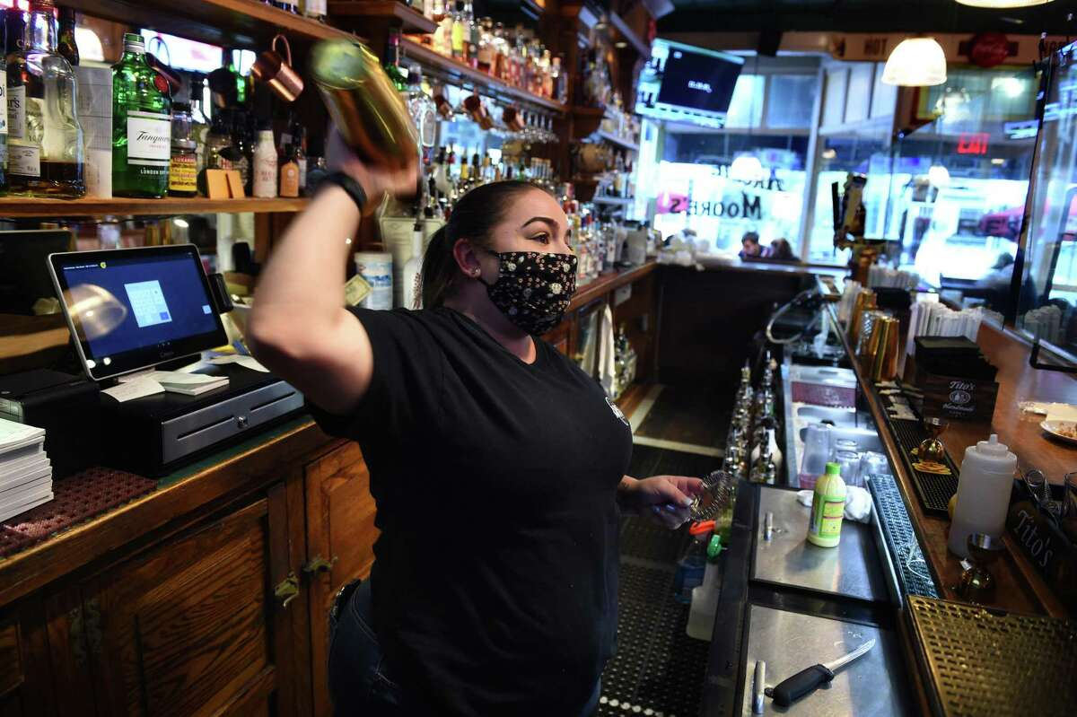 Bartender Ashlie Kelman shakes a Key Lime Martini at Archie Moore's Bar & Restaurant in New Haven on April 27, 2021.