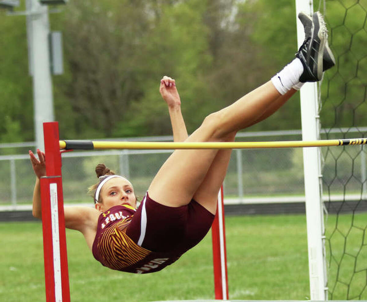 EA-WR's Hannah Sechrest watches the bar as her legs safely clear during the Bert Trump Relays on Tuesday at Southwestern High School's Knapp Field in Piasa. Sechrest was the last high jumper alive, clearing 5-foot-3 before calling it a night.