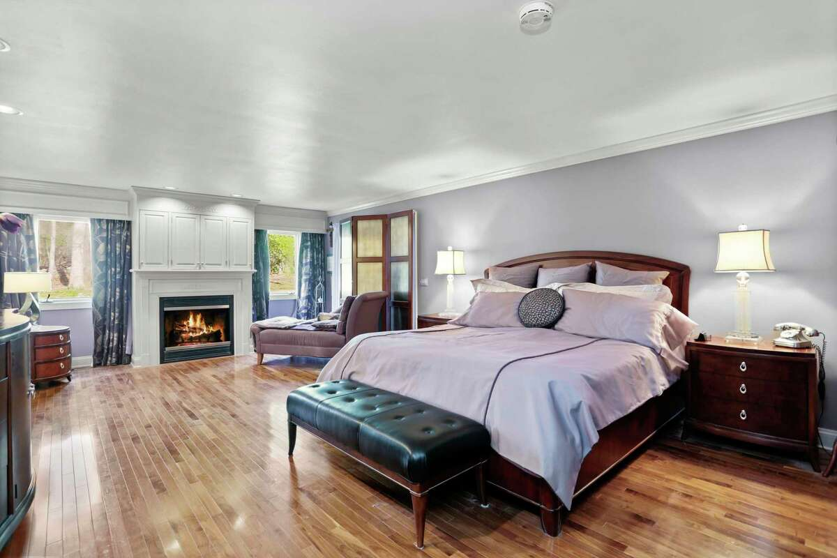 Master suite with fireplace at 212 Fence Row, Fairfield.