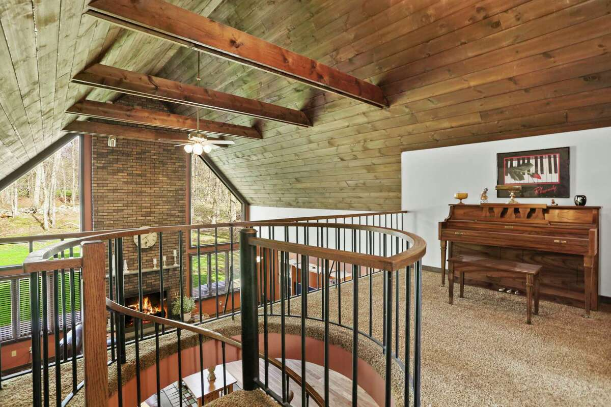 Spiral staircase to the second floor loft landing at 212 Fence Row, Fairfield.