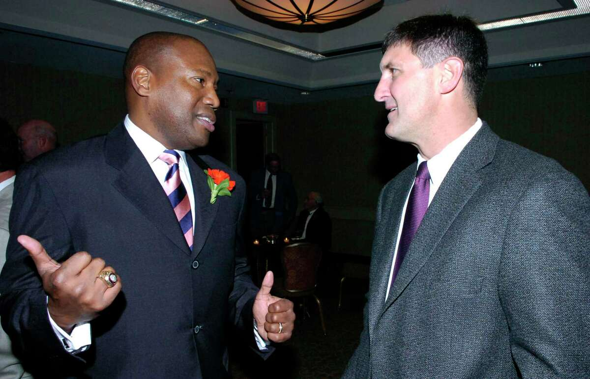 112007--Hyatt--Greenwich--Former New England Patriot wide receiver Cedric Jones and GHS Athletic Director Gus Lindine chat. Keelin Daly/ Staff Photo Old Timer's dinner. Greenwich Scene