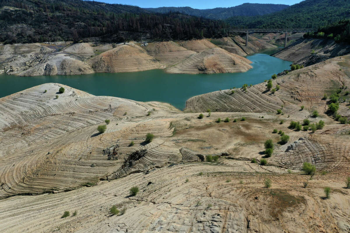 Low water levels are visible at Lake Oroville on April 27, 2021 in Oroville, California. Four years after then California Gov. Jerry Brown signed an executive order to lift the California's drought emergency, the state has re-entered a drought emergency with water levels dropping in the state's reservoirs. Water levels at Lake Oroville have dropped to 42 percent of its 3,537,577 acre-foot capacity.