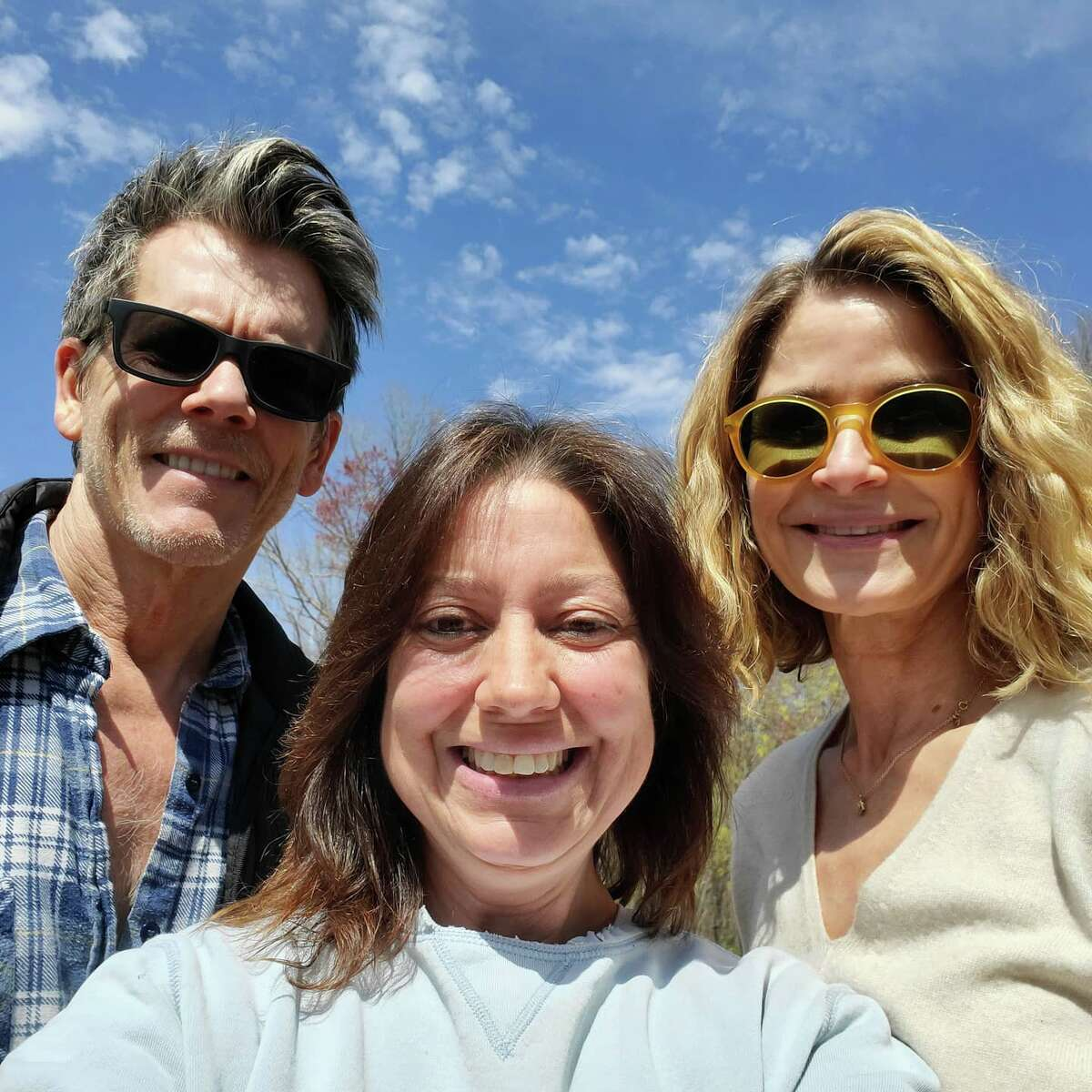 Actors Kevin Bacon (left) and Kyra Sedgwick(right) took a selfie with Tracy Longoria, owner of Aussakita Acres Farm in Manchester, Conn. on Tuesday, April 27, 2021. The actors selected two goats from the farm to join the two they purchased from the farm in 2020.