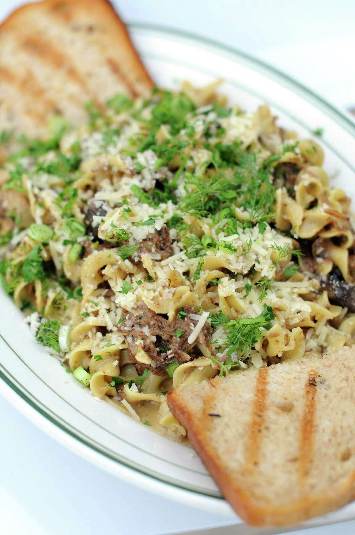 The barbacoa Stroganoff at The Hayden combines slow-braised beef cheeks, egg noodles, mushrooms and peas in a creamy sauce topped with oodles of fresh dill.
