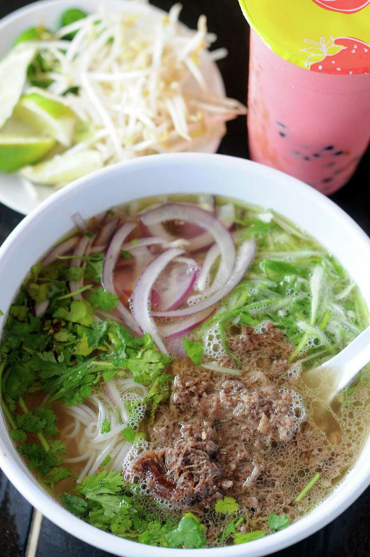 The barbacoa pho at Suck It: The Restaurant tastes surprisingly San Antonio, featuring a tangle of barbacoa swimming in a bowl of beefy broth garnished with red onion, scallions, cilantro and jalapeños.