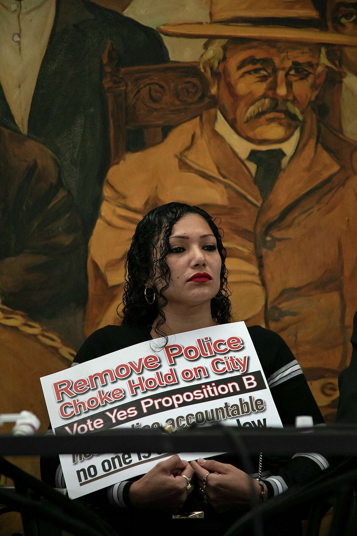 Blanca Aguirre, whose husband, Jesse Aguirre, died during an arrest by San Antonio Police Department officers in 2013, attends a press conference at Pico de Gallo restaurant.