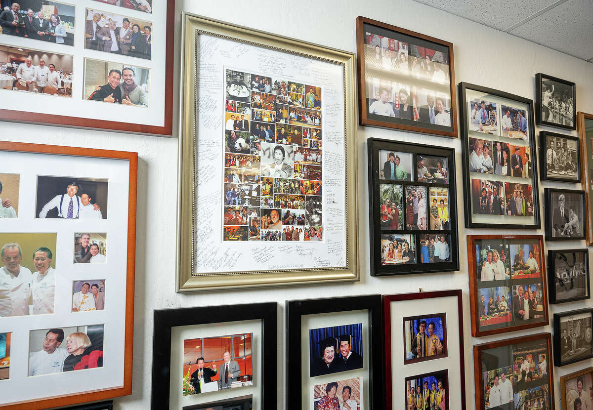 A view of chef Martin Yan's photographs and memorabilia in his office. Yan's career launched with a cooking show in Canada in 1978 that later became