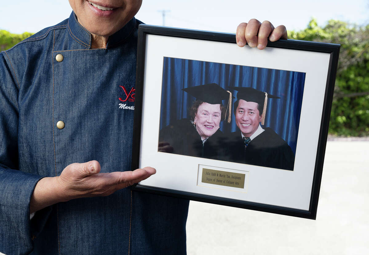 Chef Martin Yan shares an undated photograph with Julia Child when they received an honorary doctorate degree in culinary arts from Johnson & Wales University.