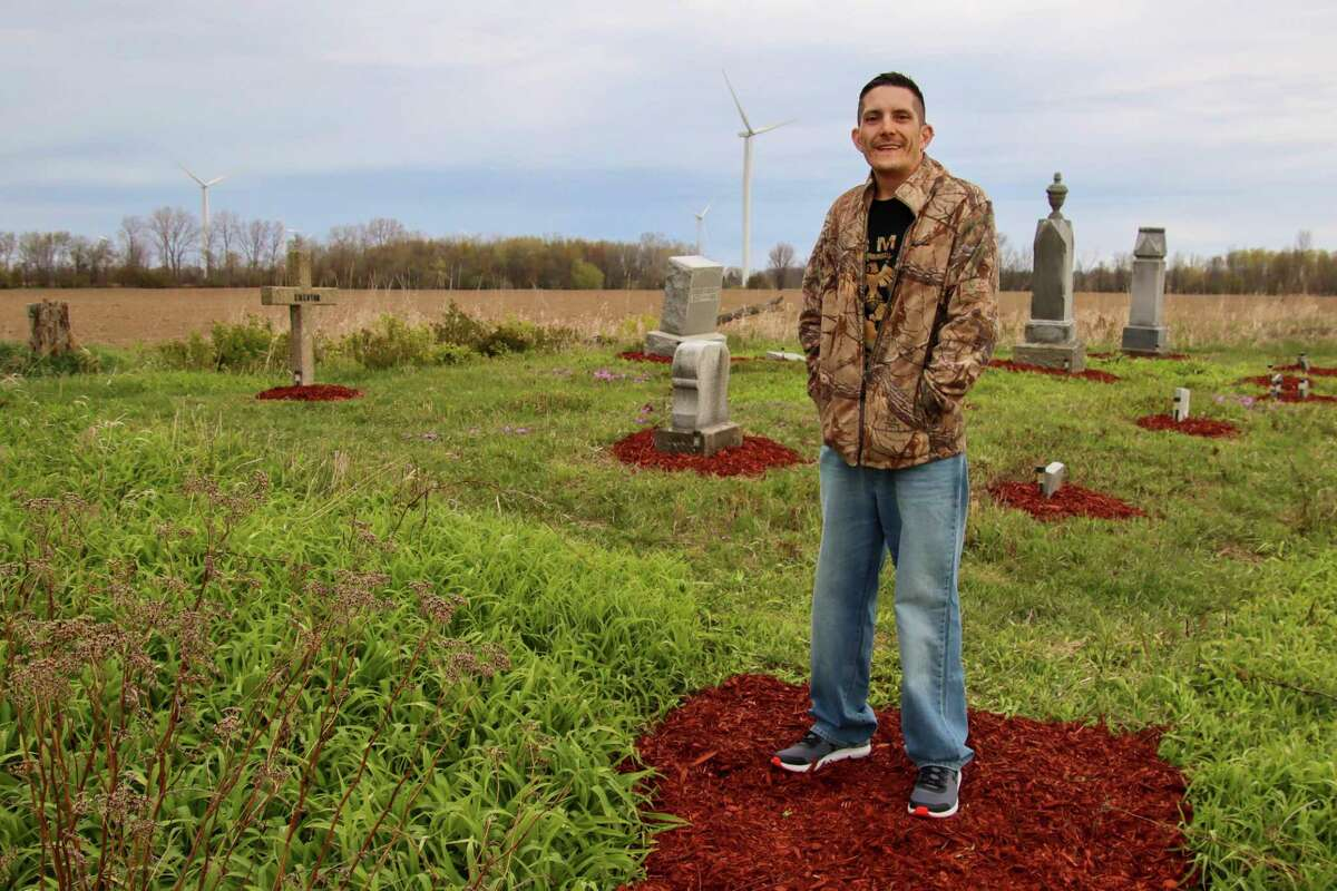 Elkton native Nathaniel Dexter stands at the entrance of McKay Cemetery in Chandler Township. Dexter started taking care of the cemetery after watching it fall into decay. (Scott Nunn/Huron Daily Tribune)