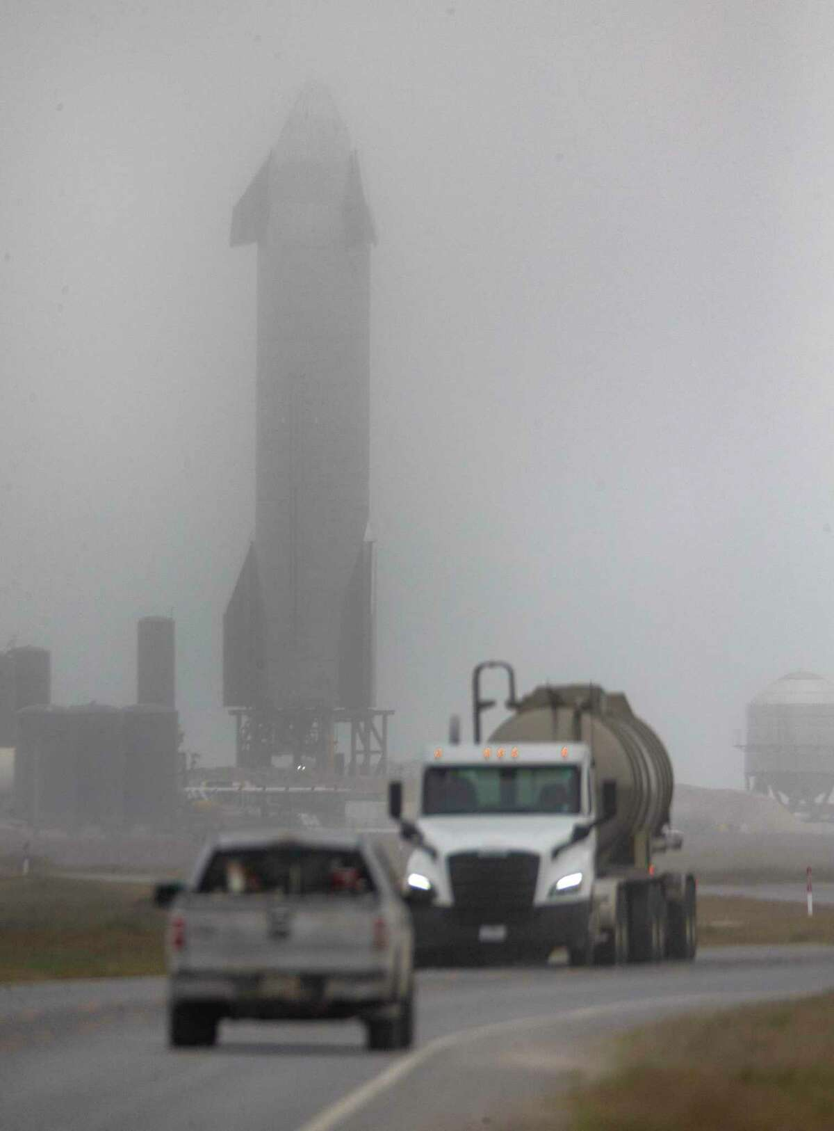 The SpaceX-built Starship SN10 sits obscured on the launch pad Monday, March 1, 2021 in Boca Chica in far south Texas after Monday's scheduled launch was scrubbed due to poor weather conditions. The launch has been rescheduled for some time during the day, Wednesday, March 3, 2021.