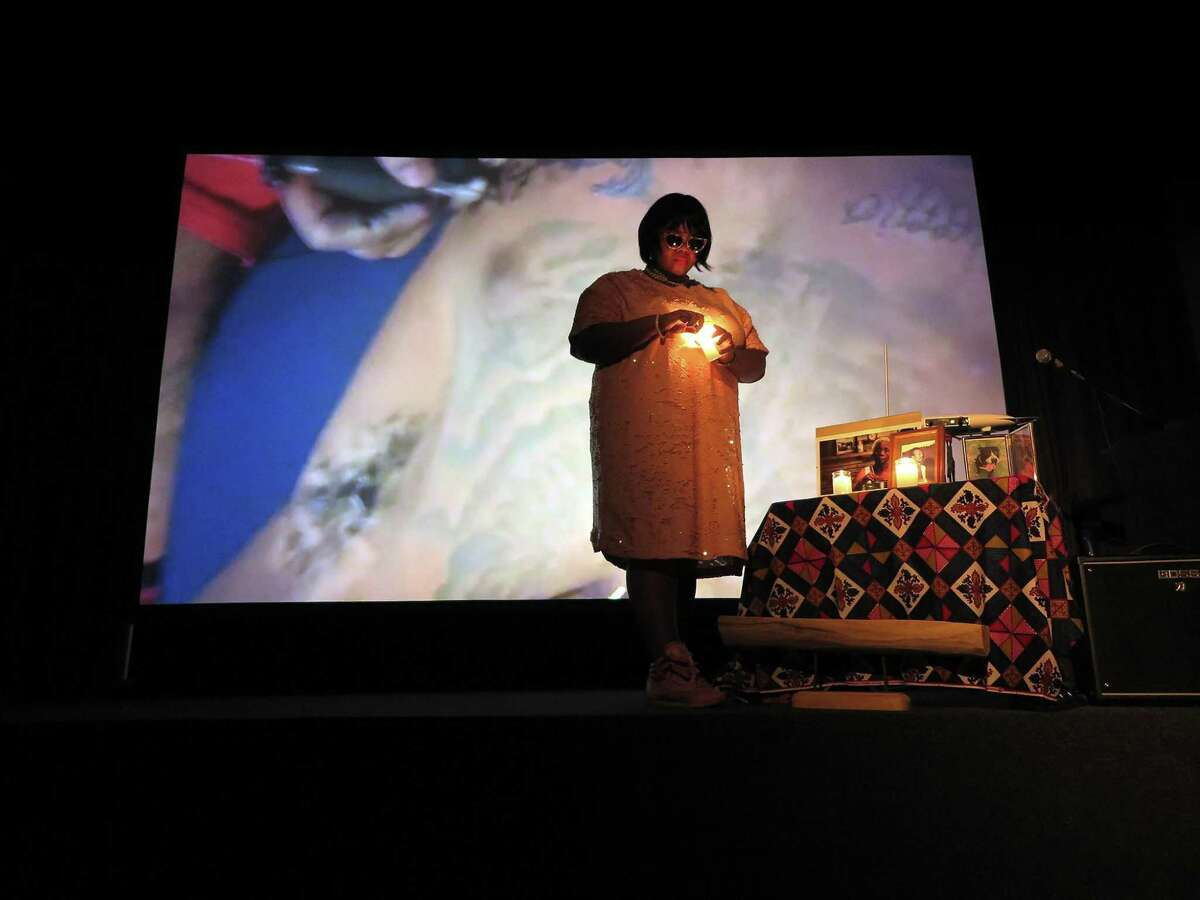 """Lisa E. Harris performs live during a screening of her film """"Cry of the Third Eye - The Last Resort,"""" a collaboration with Aurora Picture Show and the Houston Public Library, funded in part with a grant dependent on the city's hotel occupancy taxes."""