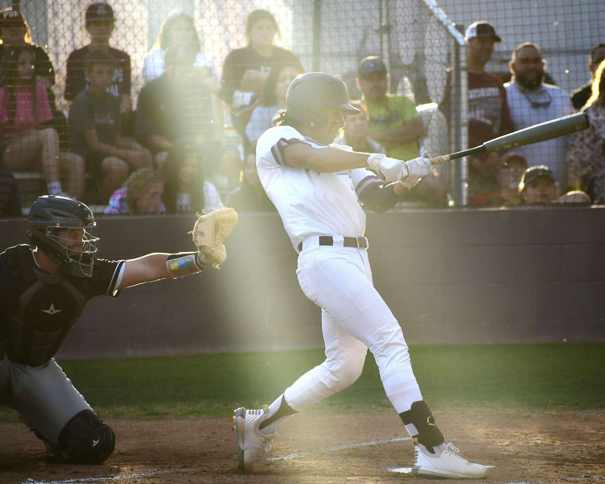 Sunlight beams direction on Abernathy's Kaeleb Carrillo has he hits an RBI single during a District 2-3A baseball game against Shallowater on Tuesday at Abernathy.