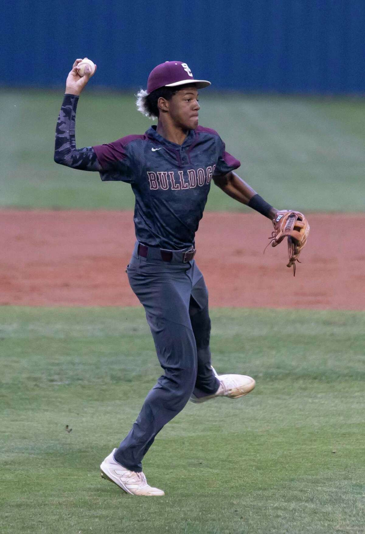 Summer Creek third baseman Ahmar Donatto (2) throws the ball toward first base during the first inning of a District 21-6A baseball game at Kingwood High School, Tuesday, April 27, 2021, in Kingwood.