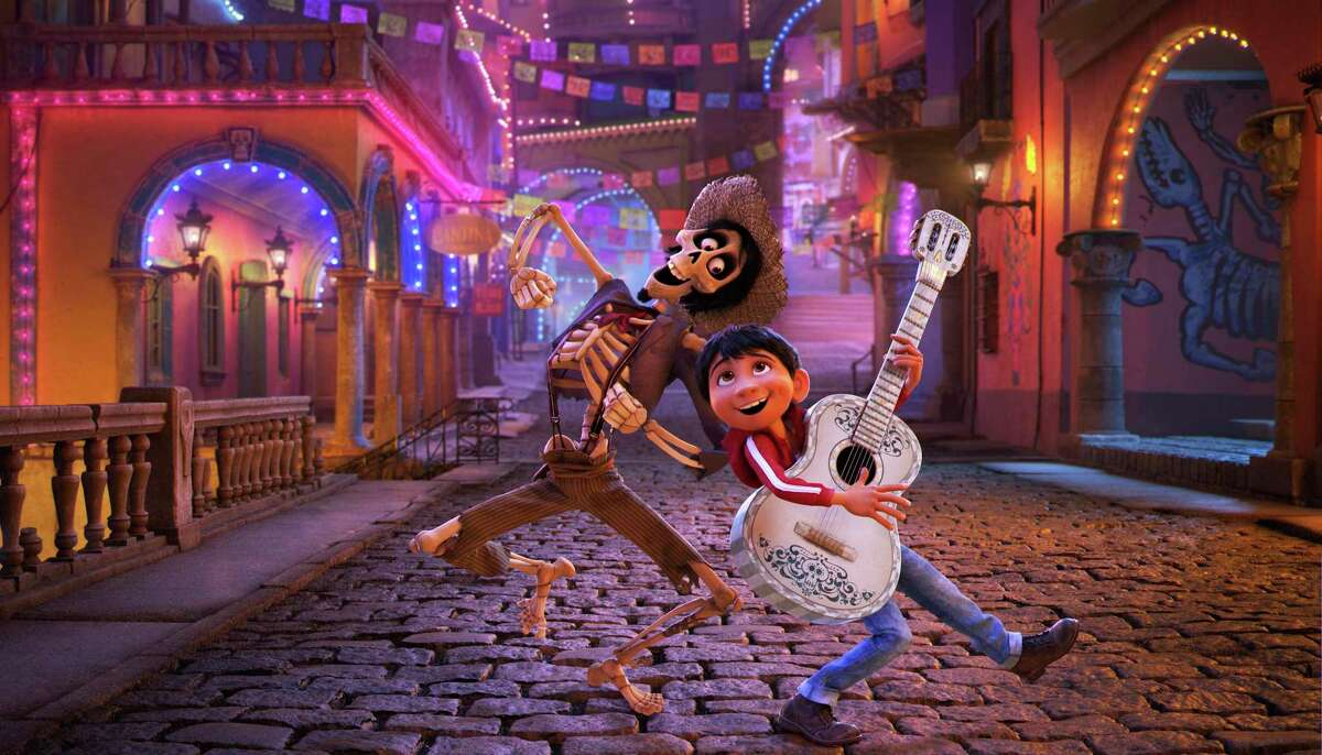 Hector (left), voiced by Gael García Bernal, and Miguel, voiced by Anthony González, travel through the Land of the Dead in