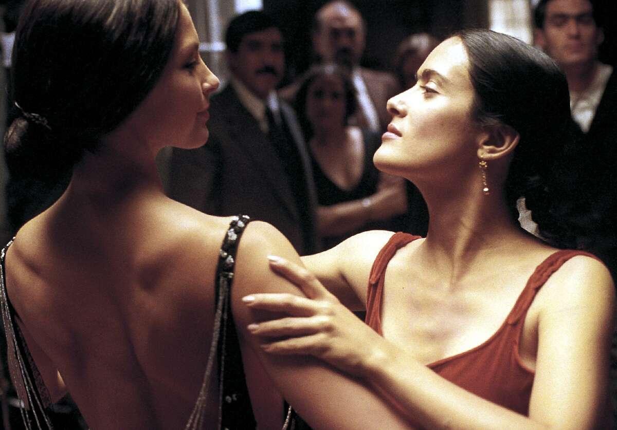 Frida Kahlo (Salma Hayek, right) shares a dance with photographer Tino Modotti (Ashley Judd) in